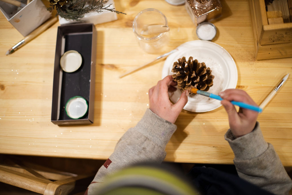 Winter Solstice festival at Real Red Riding Hoods forest school, making glittery pine cones